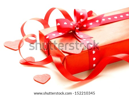red gift box with ribbon  on a white background