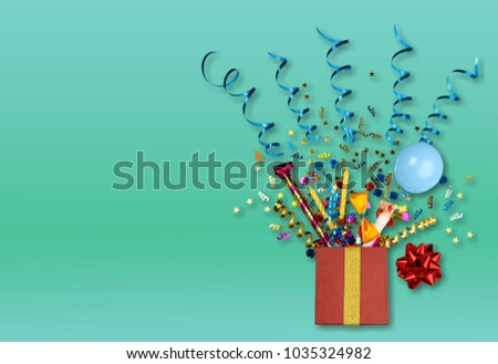 Red gift box with various party confetti #1035324982