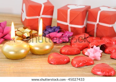 Red gift box with white candle placed beside-ideal for your valentine's background.