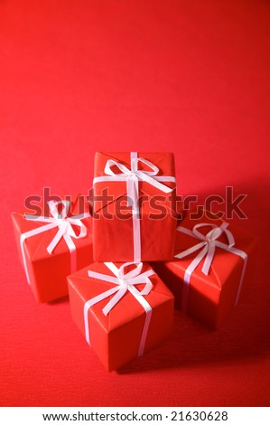Red gift boxes on a red background - stock photo