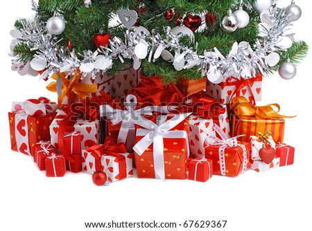 red gift boxes under decorated Christmas tree