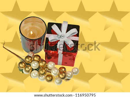 Red gift on gold star background  with grapes and candles