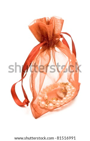 Red gift sack with pearls isolated on white