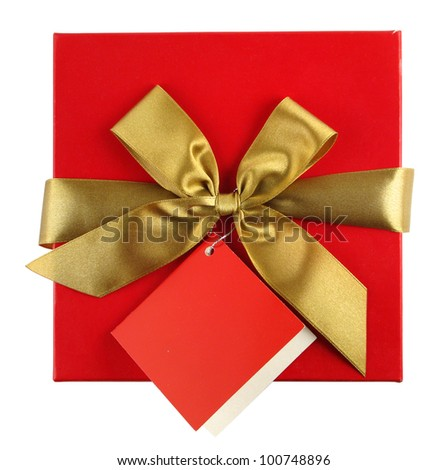 Red gift with golden ribbon and blank note