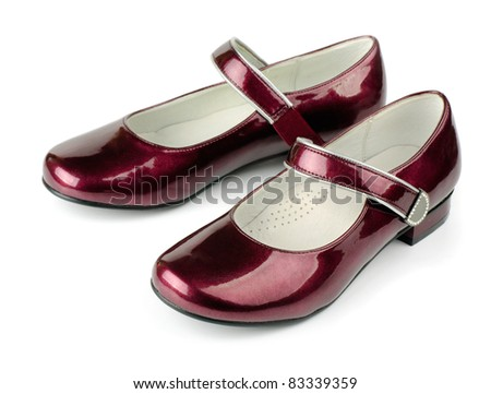 Red girls patent leather shoes isolated on white