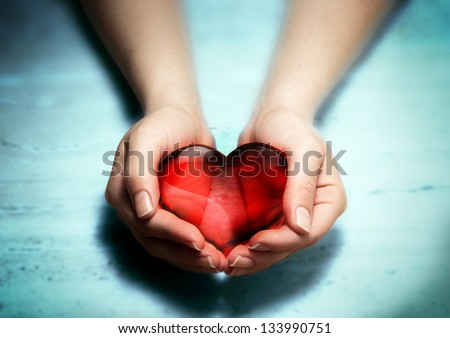 Red glass heart in woman hands #133990751