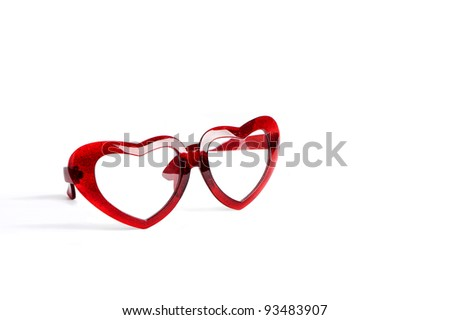 red glasses with heart shape glass isolated on white