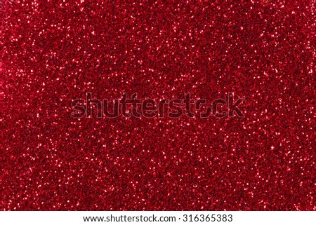 Red glitter texture christmas background.