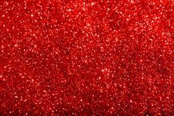 Red glitter texture. Festive sparkling sequins background closeup.