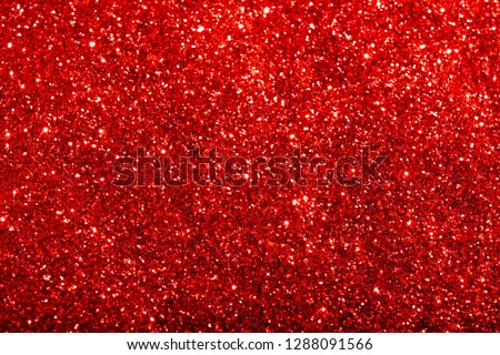 Red glitter texture. Festive sparkling sequins background closeup.