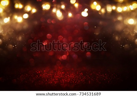 Red glitter vintage lights background. defocused.
