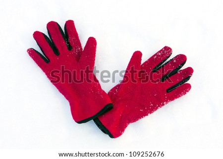 red gloves on snow surface