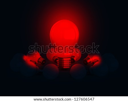Red glowing light bulb lamp illuminates on dark.