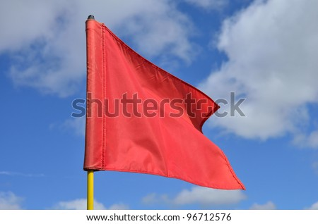 Red Golf Flag Waving in the Breeze