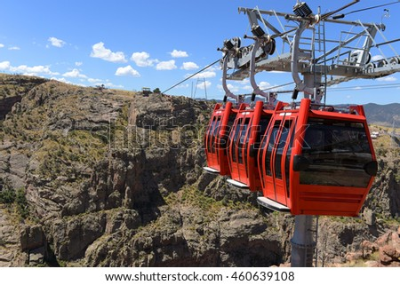 Red gondolas at the Royal Gorge in Colorado over the Arkansas river
