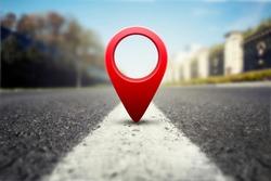 Red GPS pin on asphalt highway background