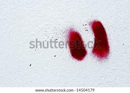 Red graffiti art marks on white wall