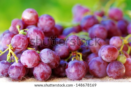 red grape fruit, on table