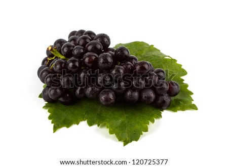 Red grape with green leaf  isolated on white background