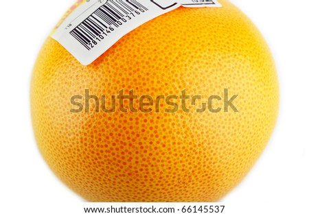 Red grapefruit with bar code sticker isolated on white