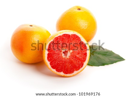 Red grapefruits isolated on white