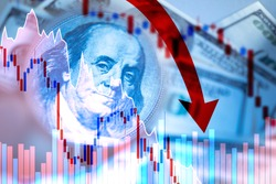 Red graph and arrows on the background of dollars. The fall of the economy. The fall of the financial market. Currency market. Economic crisis. The dollar is going down. Red arrow next to Franklin