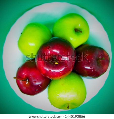 Red & Green Apples Picture from Above on White Dish with Green Background