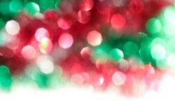 Red green blurry background holiday tinsel photo banner. New year tinsel background blurred lights for holiday design art.