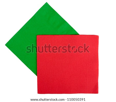 Red, green Christmas or festive napkins aka serviettes, isolated - stock photo