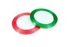 Red, green decorative satin ribbons on a white background. Spools ribbon isolated on white. Two skeins satin band. Set of hank of tapes.
