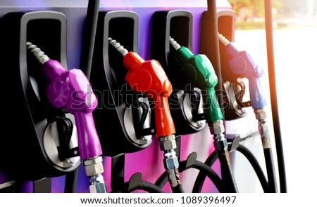 red green yellow orange color fuel gasoline dispenser  background energy crisis