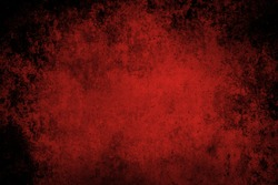 Red grunge textured wall closeup
