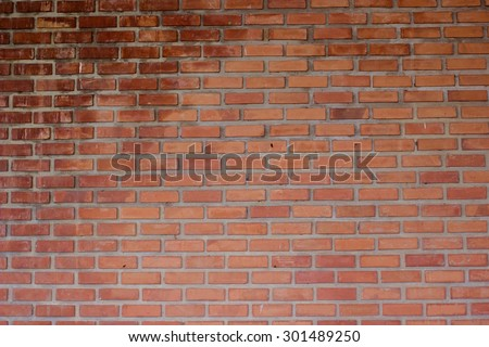 red grungy brick stone cement backgrounds textured with vignette. for decorate and design