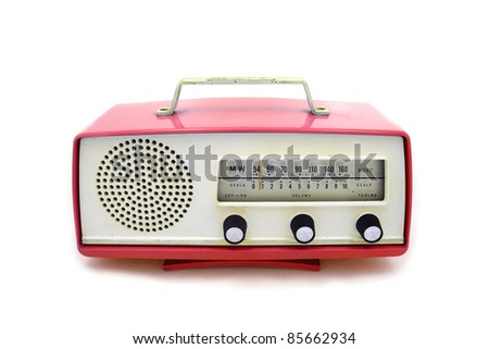 Red grungy retro radio on  isolated white background