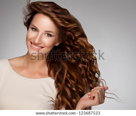 Red Hair Beautiful Woman with Curly Long Hair High quality image