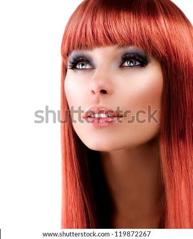 Red Hair Beauty Model. Beautiful Girl With Long Healthy Hair. Professional Makeup. Make-up. Isolated on a White Background