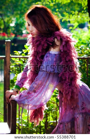 red hair elegant woman outdoor portrait