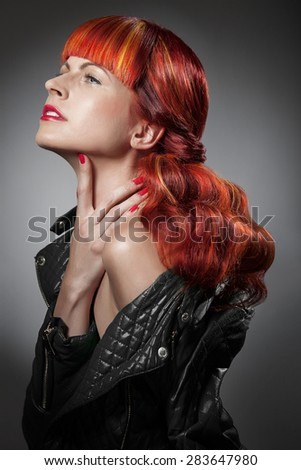 Red Hair. Fashion Girl Portrait isolated over black background