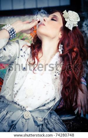 red hair fashion woman smoking cigarette, outdoor shot