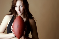 Red Hair female holding football