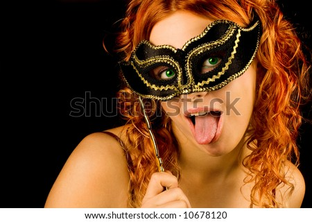 Red hair girl with mask in your hand