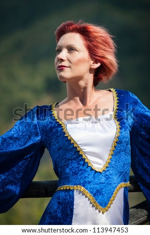 Red hair woman portrait with vintage blue dress.