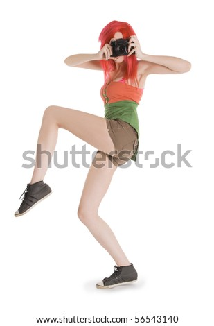 Red-hair young girl with photocamera isolated on white