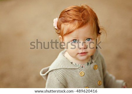 Red-haired baby girl close-up portrait