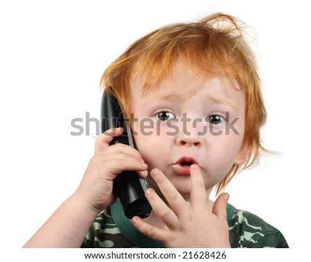 Red haired boy talking on the phone