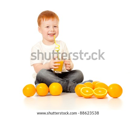 red-haired boy with orange juice and oranges isolated on white