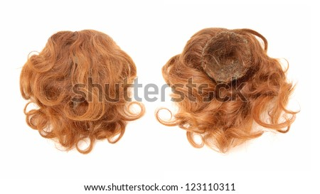 Red-haired chignon is made of natural hair.