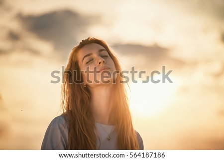 red-haired girl at sunset