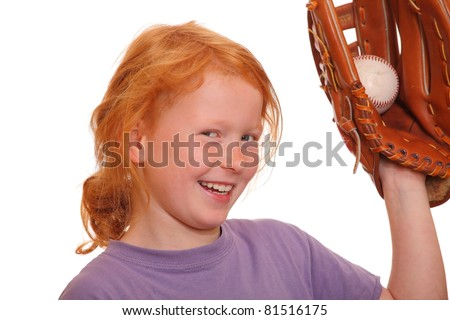 Red haired girl holding a baseball
