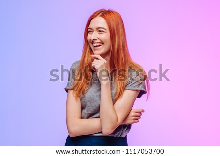 Red-haired girl laughs and rejoices #1517053700